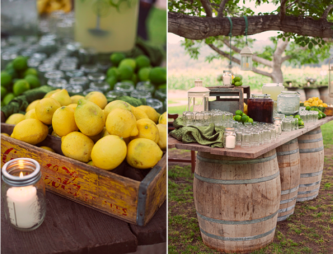 real limes and lemons in wood crate at drink station