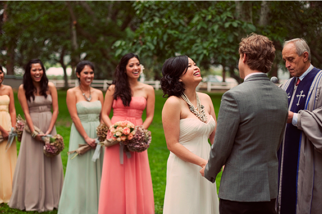 Styled California wedding ceremony - bride and groom hold hands