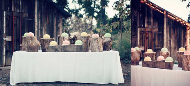 Round colored wedding cakes on log stumps
