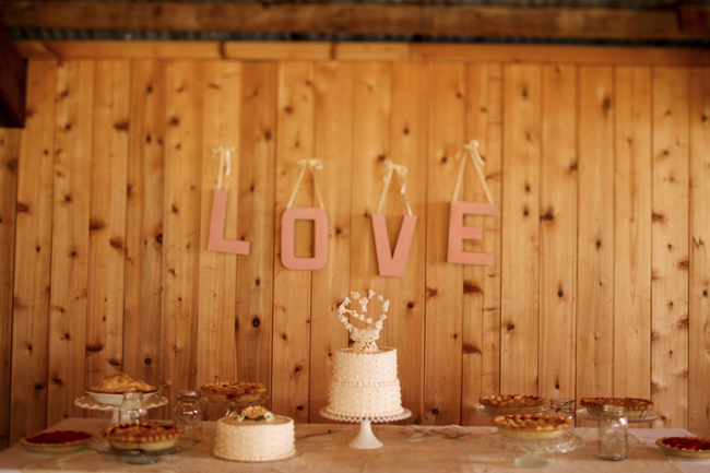 Swans Trail Farms wedding dessert table with LOVE sign on wood wall
