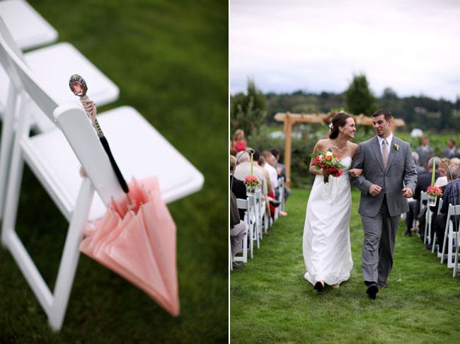 Vintage style barn wedding ceremony with pink umbrella