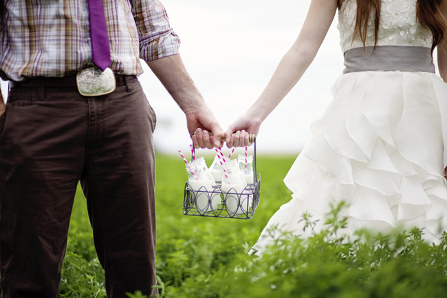 styled wedding shoot bride ang groom hold milk basket