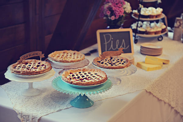 pies on wedding dessert table with banners