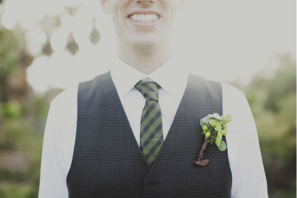 Green and Ivory wedding groom with tie and boutonniere