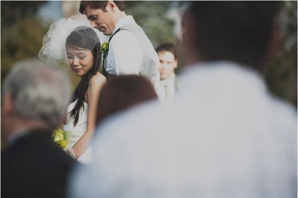 Bride and groom at outdoor wedding ceremony in California