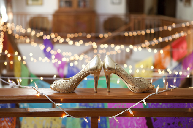 gold color heels on wood bench