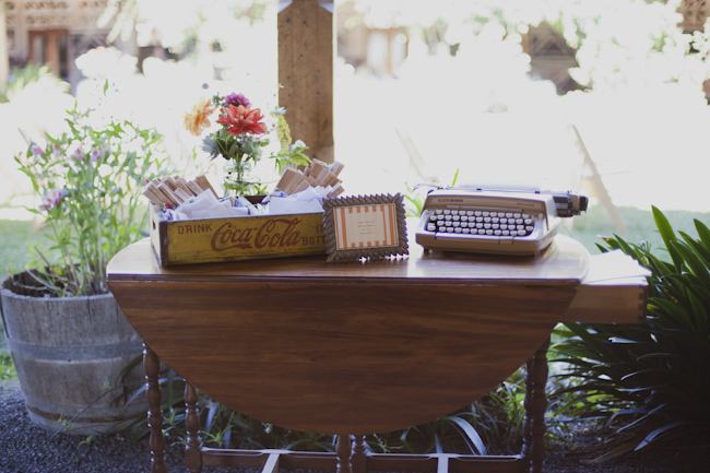 vintage table with typewriter and old coca-cola box