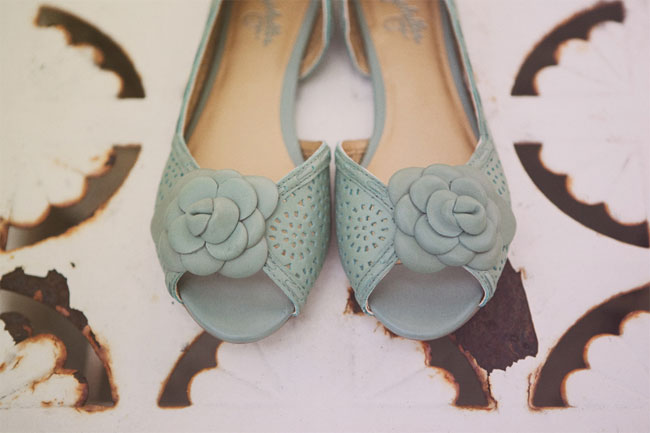 bride's turquoise shoes with flower petal design