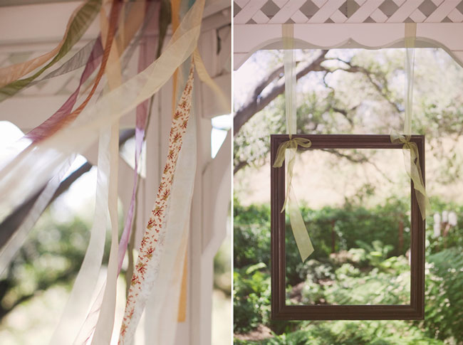 flowing strips of material hanging from gazebo windows; picture frame hung in gazebo window