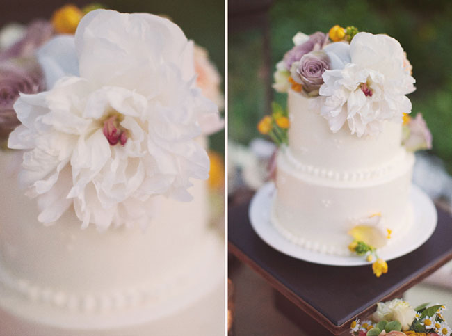 close-up of wedding cake with fresh flowers