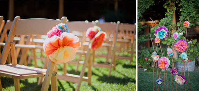 colorful paper flowers as aisle markers