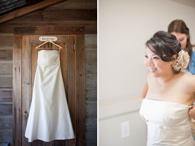 white wedding dress hanging on wooden door at Radonich Ranch wedding, and photoof bride getting ready