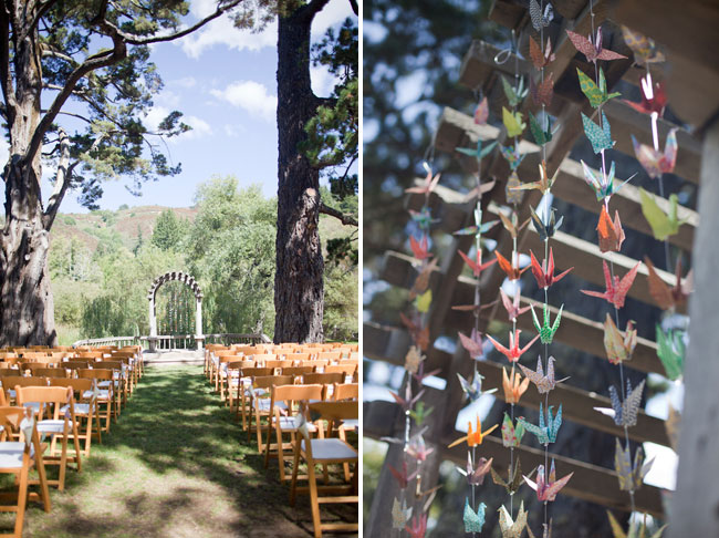 Whimsical outdoor wedding ceremony with colored paper crane strings hanging