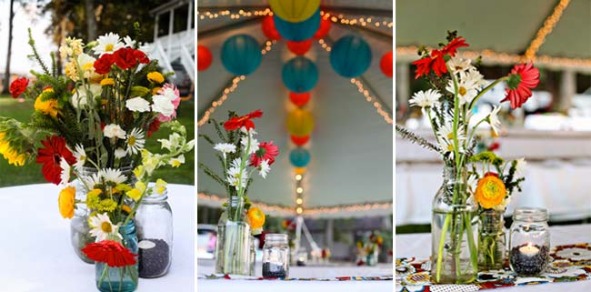 jars of daisies and colorful paper lantern decorations on roof of tent