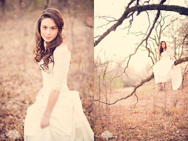 Bride sitting on tree limb in white dress and red heels at vintage bridal session