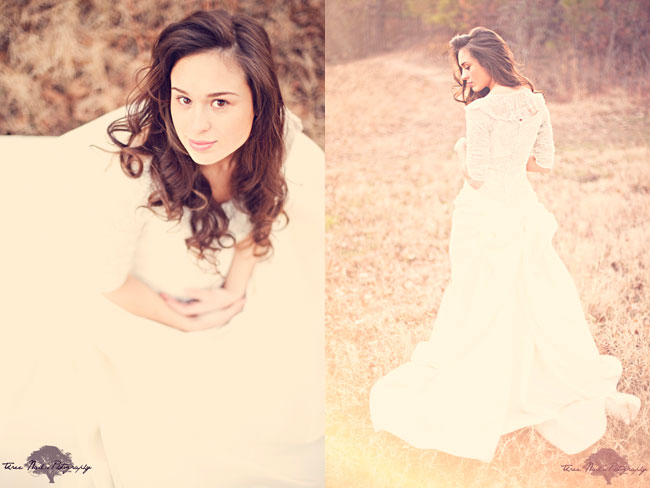 Beautiful bride in white dress walks through open field next to woods at vintage bridal session