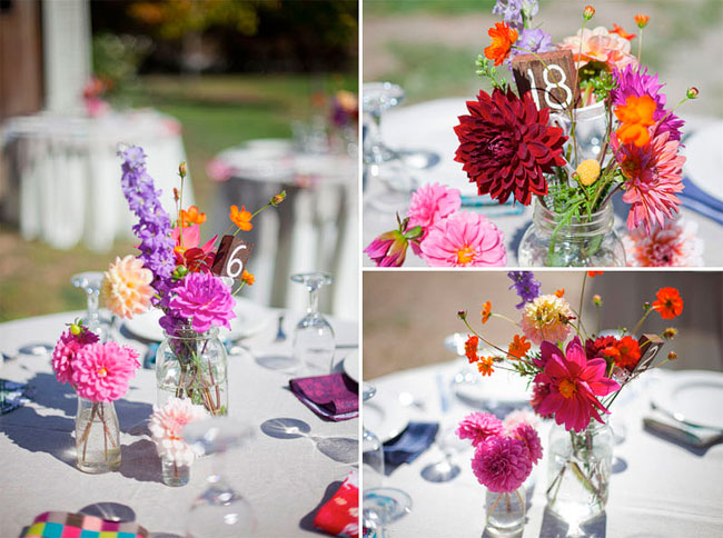 Simple Pink, red, orange, and purple flower centerpiece at outdoor wedding