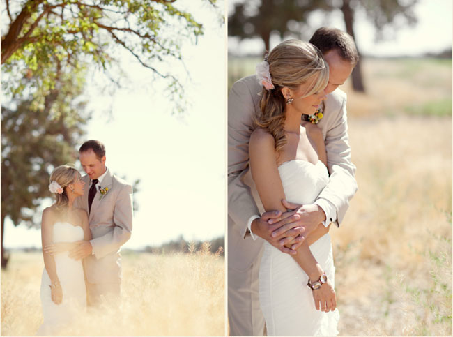 bride and groom embrace in Oregon field under tree
