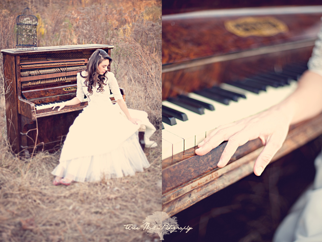 Bride sitting at old piano in the woods in white dress at vintage bridal session