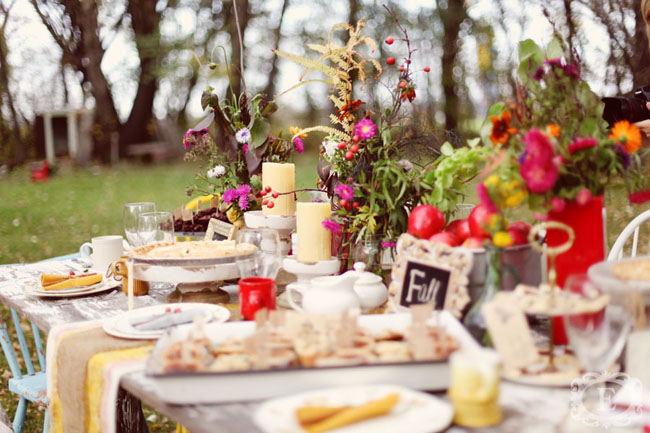 Colorful flowers on old wooden table for outside picnic