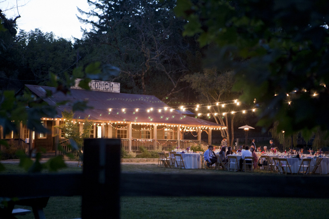 radona ranch wedding reception at night with light strings overhead