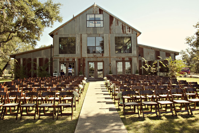 Wedding at Vista West Ranch ceremony chairs setup in front of barn