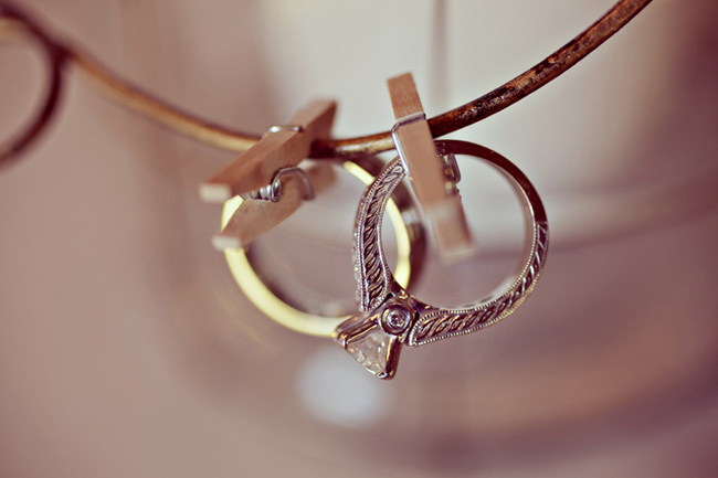 wedding rings attached to metal with clothespins