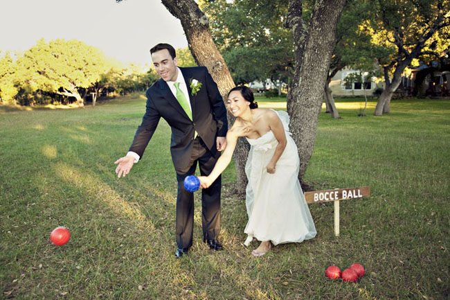 bride and groom throw bocce balls on lawn at Vista West Ranch wedding reception