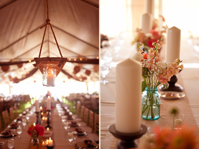 large white candles on tent wedding reception table