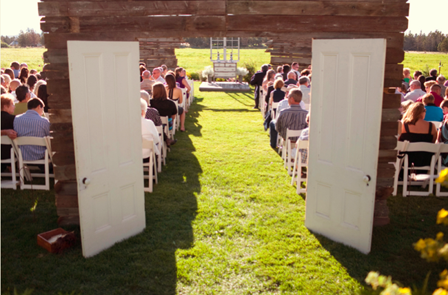 doorway made from old barn wood opening to ceremony aisle