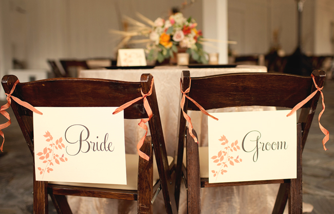 country charm wedding bride and groom seats with signs