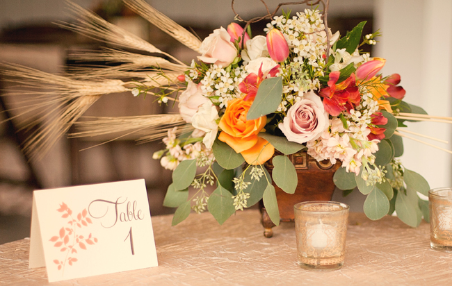 centrepiece flower arrangement, candles, and table number