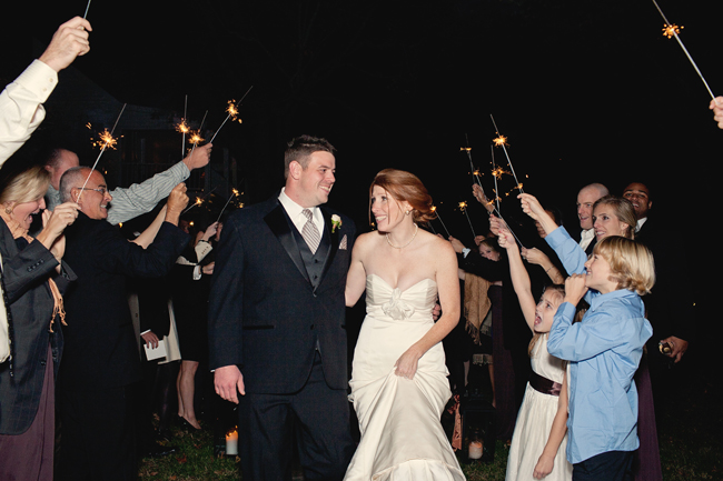 celebration with sparklers as bride and groom exit