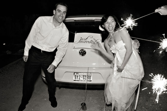 black and white photo of bride and groom sparkler sendoff with VW car