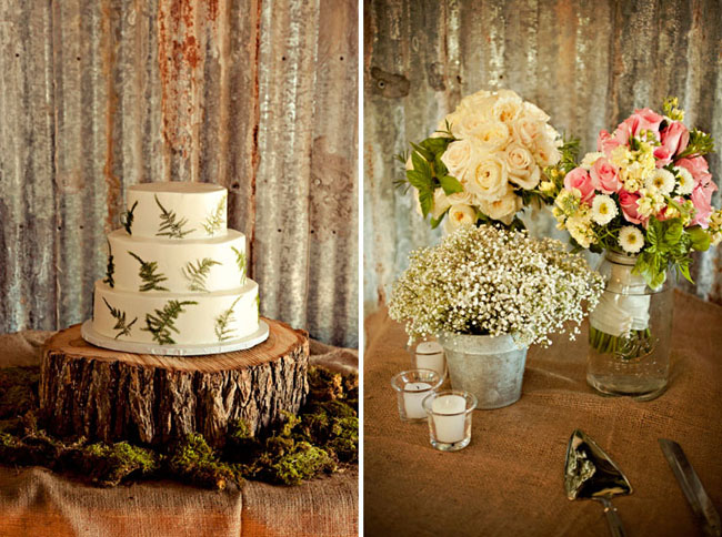 3-tier wedding cake with pressed ferns sitting on giant wood slice