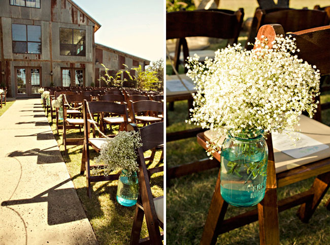 Wedding at Vista West Ranch barn with baby's breath in mason jars on end of aisle chairs