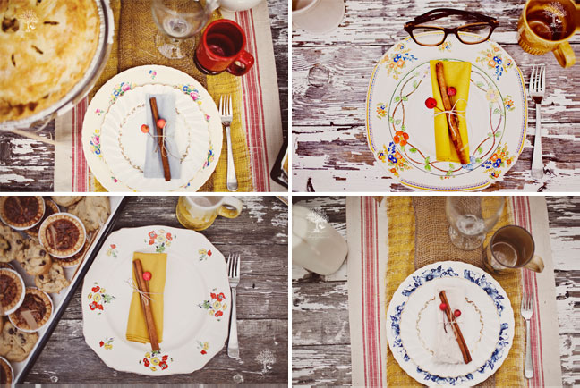 Mismatched china place setting for outdoor picnic at old wooden table.  Yellow and white napkins folded and tied with cinnamon and berries and twine