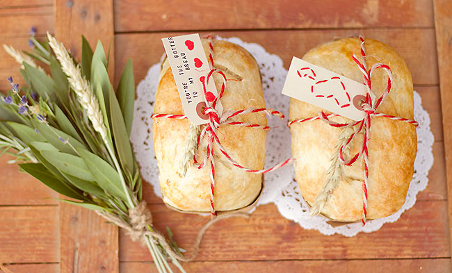 bread and butter inspiration - loaves of bread tied with red and white twine with a note attached