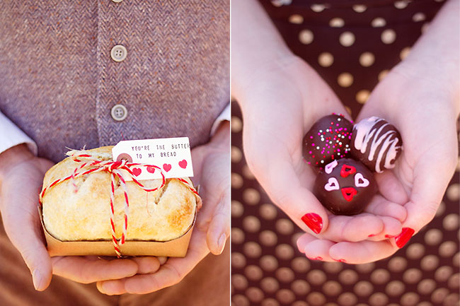 Groom holding mini loaf of bread in both hands while bride hold three chocolate truffles in her hands