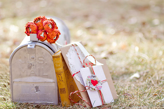 Bread and butter inspiration shoot with mailbox and old books with cards laying on the ground together