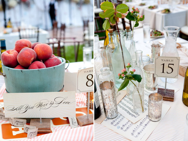 basket of peaches, carraf, table numbers, sheet music and more on center of wedding reception tables for wedding reception at private estate