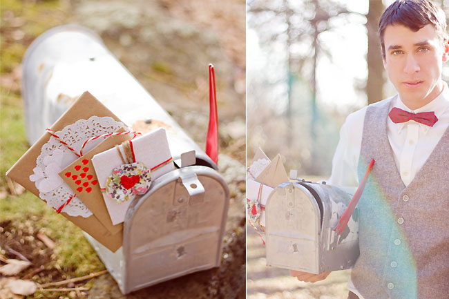 Groom in red bowtie holds postal box under arm at engagement shoot