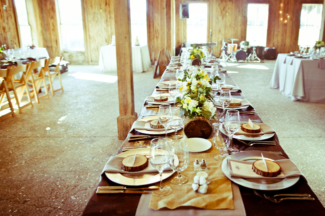 Wedding reception tables inside Boone Hall Plantation barn