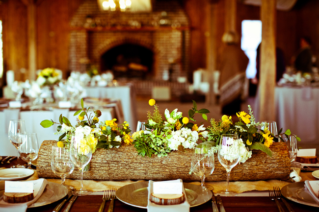 log centerpiece cut out with flowers inside