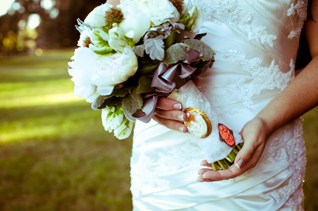 Bride standing outside holding bridal bouquet