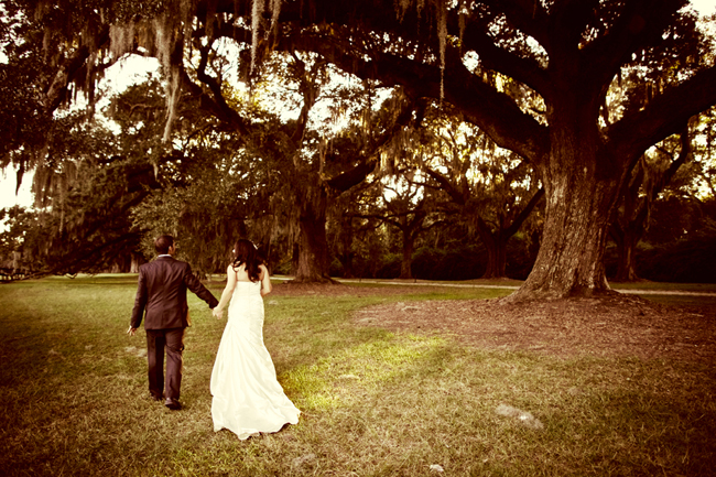 Kip and Liz walk among giant moss covered oak trees at Boone Hall Plantation