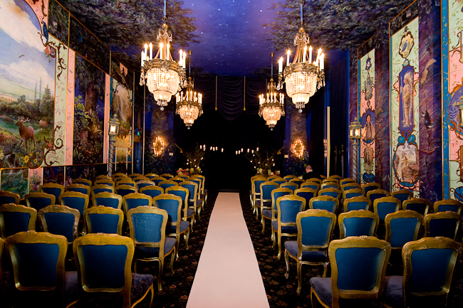 The Ruins wedding venue in Seattle with magnificent chandeliers and funky chairs