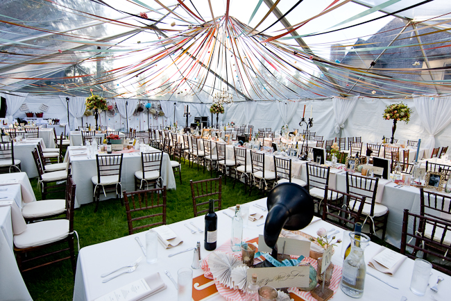 carnival wedding reception - table settings with colorful draping overhead and a gramaphone as a centerpiece
