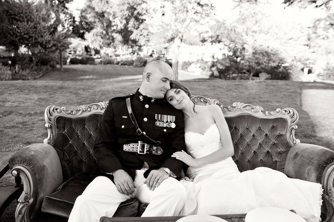 bride and groom on vintage sofa outdoors at the Inn at Rancho Santa Fe