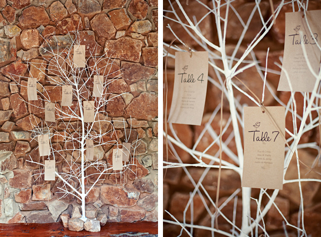 Unique wedding table number tree painted white set against a rock wall at Red Ivory Lodge
